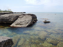 Caspian Sea. Water splashes around the stone. Caspian Sea. Kazakhstan stock images