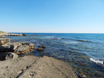 Caspian Sea. Water splashes around the stone. Caspian Sea. Kazakhstan royalty free stock photography
