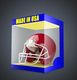 Casque de football américain rouge dans la boîte transparente Photos libres de droits