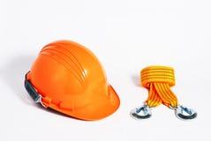 Casque de sécurité orange avec l'élingue en nylon photo stock
