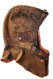 Casque en cuir de vintage au-dessus du fond blanc Image stock