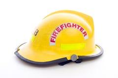 Casque jaune de chasseurs d'incendie Photo libre de droits