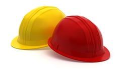 casque rouge et jaune de construction Photographie stock libre de droits