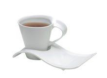 Casquillo blanco con té Imágenes de archivo libres de regalías