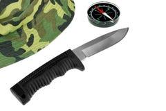Casquillo, cuchillo militar y compás aislados Fotos de archivo