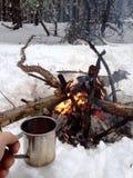 Casquillo del té y del fuego Fotografía de archivo