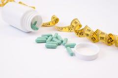Casquillo farmacéutico obeso s de la tapa del gimnasio de la medicación de las vitaminas de la reducción fotos de archivo