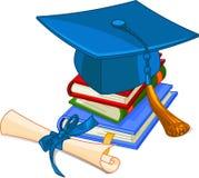 Casquillo y diploma de la graduación Fotografía de archivo libre de regalías