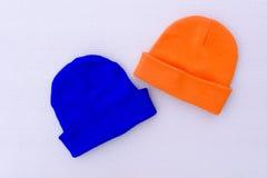 Casquillos anaranjados y azules Foto de archivo libre de regalías