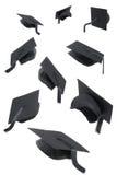 Casquillos de la graduación en blanco Imagenes de archivo