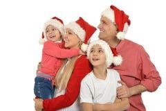 Casquillos del día de fiesta de la Navidad de la familia que llevan Foto de archivo libre de regalías