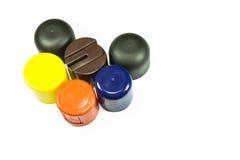 Casquillos plásticos coloreados Fotografía de archivo libre de regalías