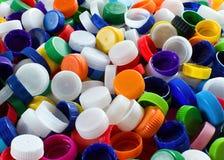 Casquillos plásticos coloridos Imágenes de archivo libres de regalías