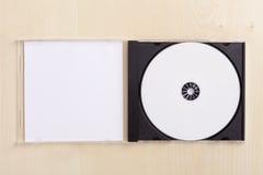 Cassa CD in bianco su legno fotografia stock libera da diritti
