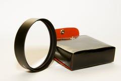 Cassa dell'annata ed anello dell'obiettivo Fotografie Stock Libere da Diritti