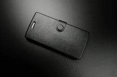 Cassa nera per il telefono cellulare Fotografie Stock Libere da Diritti