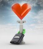 Cassaforte il vostro concetto di amore con il focolare nel cielo Fotografia Stock
