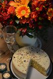 Cassata cake with flower bouquet. On the wooden table royalty free stock images