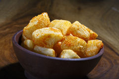 Cassava cookie fried. Cassava cookie on a wooden bowl Royalty Free Stock Photos