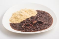 Cassava Farofa with Black Beans cooked. Cassava Farofa with Black Beans cooked on white background Royalty Free Stock Photography