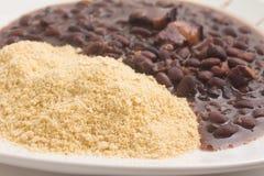 Cassava Farofa with Black Beans cooked. Cassava Farofa with Black Beans cooked on white background Stock Photos