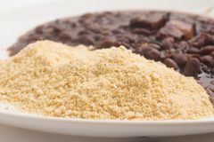 Cassava Farofa with Black Beans cooked. Cassava Farofa with Black Beans cooked on white background Stock Photo