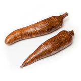 Cassava or Manioc Root, Isolated. Two Cassava or manioc root tubers, edible starchy tuberous roots when dried is called tapioca Stock Photography