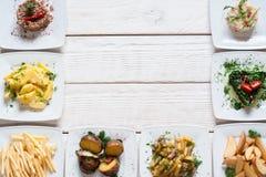 Casse-croûte de légume frais sur l'espace libre blanc de table Photographie stock