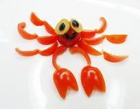 Casse-croûte végétal drôle créatif avec la tomate Photo libre de droits