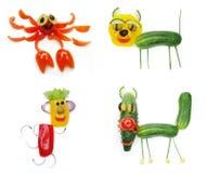 Casse-croûte végétal drôle créatif avec la tomate Photos libres de droits