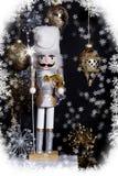 Casse-noix de Noël d'argent et d'or photographie stock
