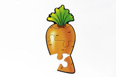 Casse-tête avec la photo de carotte Images libres de droits