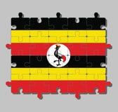 Casse-tête de drapeau de l'Ouganda dans jaune et rouge noirs ; un disque blanc dépeint le symbole national, une grue couronnée gr illustration de vecteur