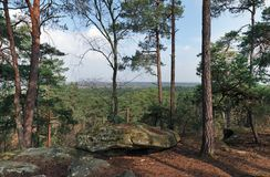 Hiking trail in Fontainebleau forest. Cassepot rock panorama in Fontainebleau forest Royalty Free Stock Images