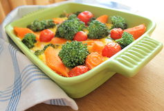 Casserole with broccoli,cherry tomatoes and carrot Stock Photo