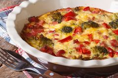 Casserole with broccoli, pepper, bacon macro. horizontal Royalty Free Stock Image