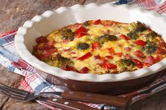 Casserole with broccoli, pepper, tomatoes and bacon. Horizontal Stock Photos