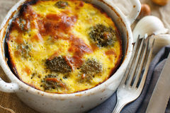 Casserole with broccoli on a rustic background Stock Images