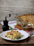 Casserole with cabbage or gratin. Under a cheese crust stock image