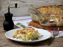 Casserole with cabbage or gratin. Under a cheese crust royalty free stock images
