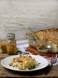 Casserole with cabbage or gratin. Under a cheese crust stock photos