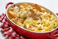 Casserole with cauliflower, leek, bread and cheese stock image