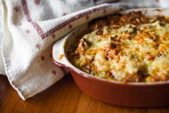Casserole with cheese. On table closeup Stock Photo
