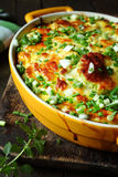 Casserole with cheese on a rural kitchen Stock Photography