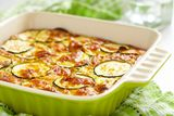 Casserole with cheese and zucchini in baking dish. See my other works in portfolio royalty free stock photography