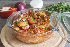 Casserole of chicken in an ovenproof dish. With vegetables Stock Image