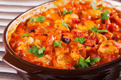Casserole with chicken, potatos and tomatos Stock Image
