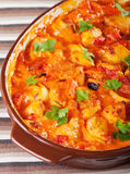 Casserole with chicken, potatos and tomatos Stock Images