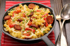 Casserole with chorizo sausage in a frying pan Stock Images