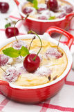 Casserole (clafoutis) with cherry in the ramekin, close-up Stock Photo